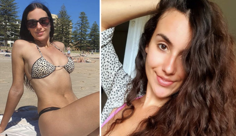 A fitness model claims she was confronted by a stranger over her G-string bikini at the beach.
