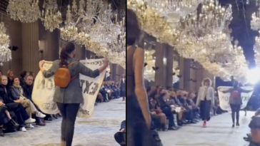 A climate activist crashed a Louis Vuitton runway show during Paris Fashion Week, before being removed by security guards.